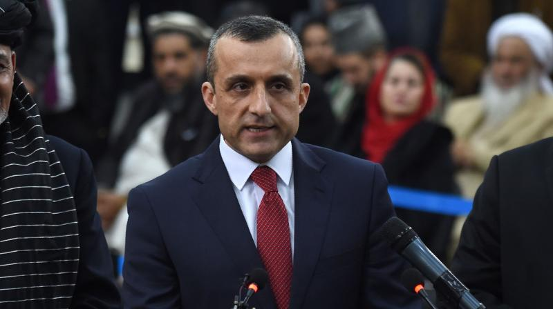 Afghan's first vice-presidenti Amrullah Saleh (C) speaks to the media at the Independent Electoral Commission office in Kabul. - At least two people were killed and a dozen more wounded in an explosion targeting the convoy of Afghanistan's vice president Amrullah Saleh in central Kabul early on September 9, officials said. (AFP File)