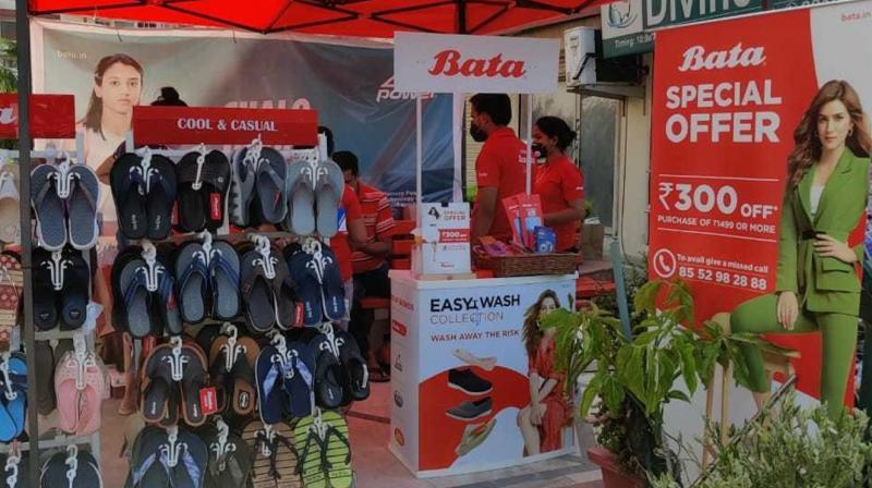A Bata worker sanitises a showroom to make it coronavirus free. (Twitter/@BATA_India)