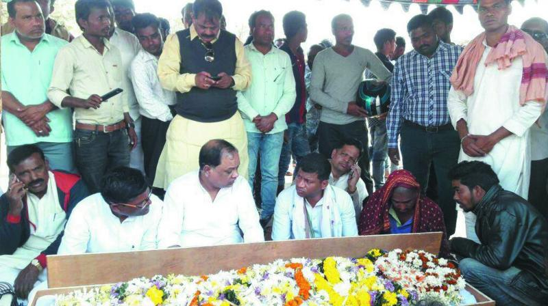 Congress leaders paying homage to the victim who committed suicide allegedly after being denied justice.