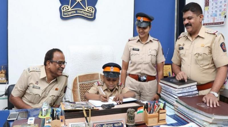 As part of a programme by the Mulund Police Station and the NGO, the jubilant Arpit Mandal donned the khaki uniform complete with a police cap, for a day. (Photo: ANI)