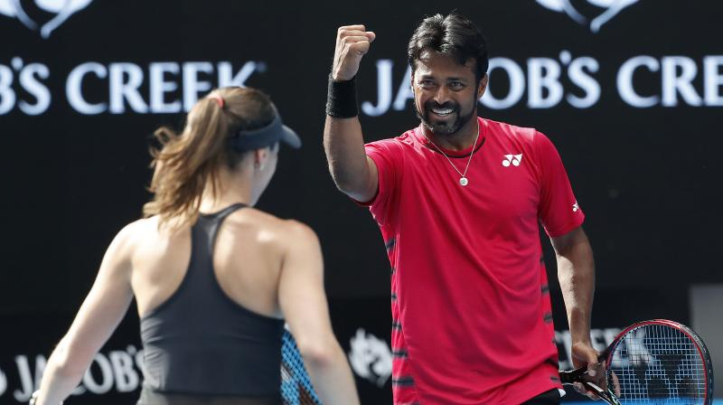 Leander Paes celebrates winning a point with Martina Hingis during their mixed double match at the Australian Open in Melbourne. (Photo: AP)