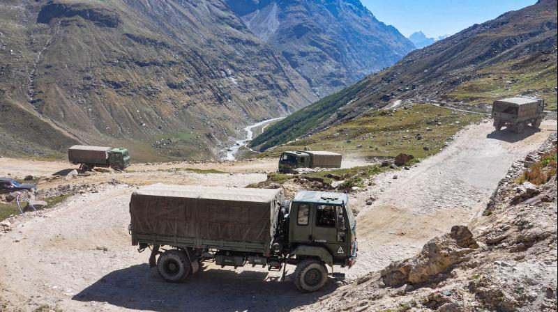 An army convoy carrying military material on its way to Ladakh amid border tension with China, at Manali-Leh highway, Saturday, Sept. 19, 2020. (PTI Photo)