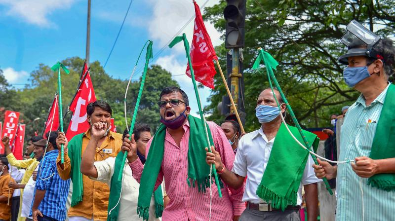 Members of various farmer organizations shout slogans during 'Bharat Bandh', a protest against the farm bills passed in Parliament recently, in Bengaluru, Friday, Sept. 25, 2020. (PTI Photo)