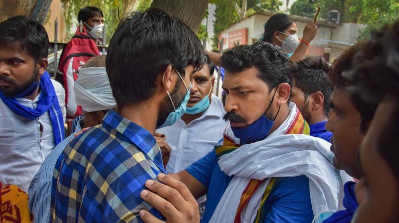 New Delhi: Chandrashekhar Azad Ravan of Azad Samaj Party (ASP) meets the family of Hathras rape victim at Safdarjang Hospital in New Delhi, Tuesday, Sept. 29, 2020. (PTI Photo)