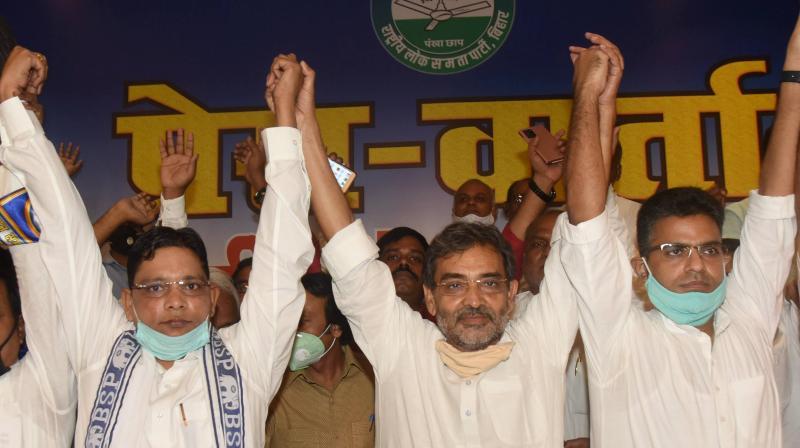 Rashtriya Lok Samata Party (RLSP) President Upendra Kushwaha (C) with Bahujan Samaj Party (BSP) Bihar in-charge Ramji Singh Gautama (L) and Janwadi party leader Sanjay Singh Chauhan (R) during a joint press conference, ahead of Bihar Assembly elections, in Patna, Tuesday, Sept. 29, 2020. (PTI Photo)