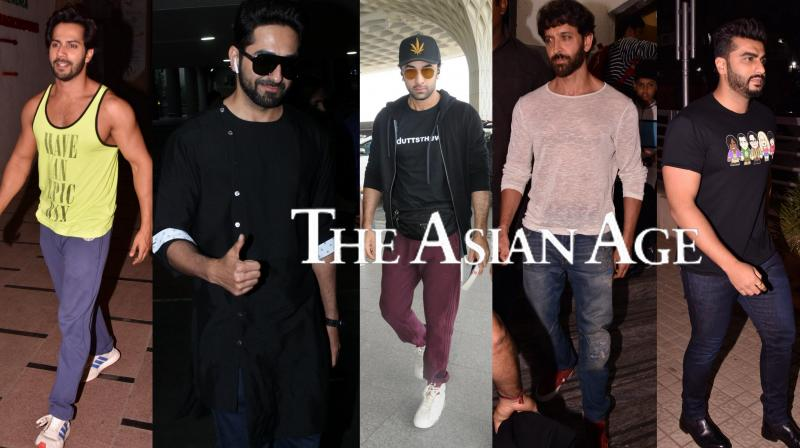 Bollywood celebrities Hrithik Roshan, Varun Dhawan, Ranbir Kapoor, Arjun Kapoor, Anil Kapoor, Ayushmann Khurrana and others were spotted in the city. See latest pictures of your favourite stars here. (Photos: Viral Bhayani)