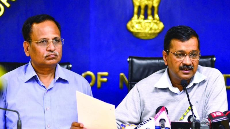 CM Arvind Kejriwal and health minister Satyender Jain at a press conference on Wednesday. (Photo: BUNNY SMITH)