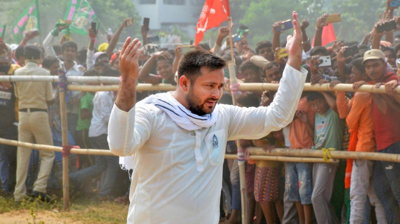 Rashtriya Janata Dal (RJD) leader Tejashwi Yadav arrives to participate in his election campaign rally ahead of Bihar Assembly Polls, at Premnagar in Rohtas district, Wednesday, Oct. 21, 2020. (PTI Photo)