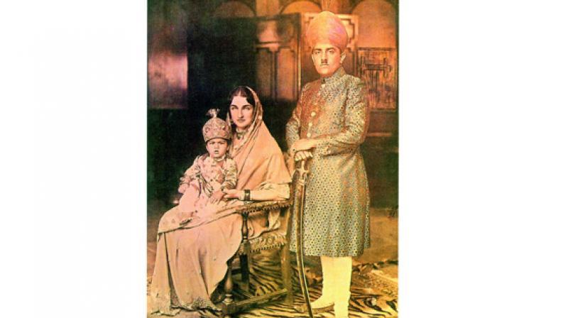 Azam Jah, Prince of Berar with his wife Princess Durru Shehvar, and eldest son Barkat Ali Khan, Mukarram Jah. Hyderabad, 1934