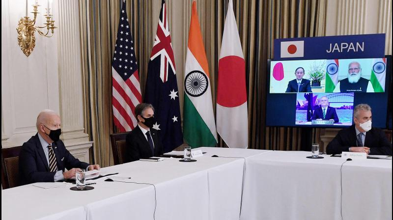 US President Joe Biden (L), with Secretary of State Antony Blinken (2nd L), meets virtually with members of the 'Quad' alliance of Australia, India, Japan and the US, in the State Dining Room of the White House in Washington, DC, on March 12, 2021. - On screen (R) are Japanese Prime Minister Yoshihide Suga, Indian Prime Minister Narendra Modi and Australian Prime Minister Scott Morrison. ( OLIVIER DOULIERY / AFP)