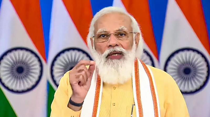 Prime Minister Narendra Modi addresses during the inauguration and foundation stone laying of multiple projects in Gujarat, via video conferencing, in New Delhi, Friday, Aug 20, 2021. (PTI Photo)