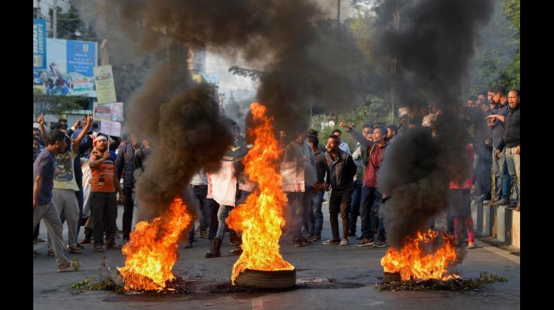 Tens of thousands of protesters against the CAB descended on the streets of Assam, clashing with police and plunging the state into chaos of a magnitude unseen since the violent six-year movement by students that ended with the signing of the Assam accord. (Photo: PTI)