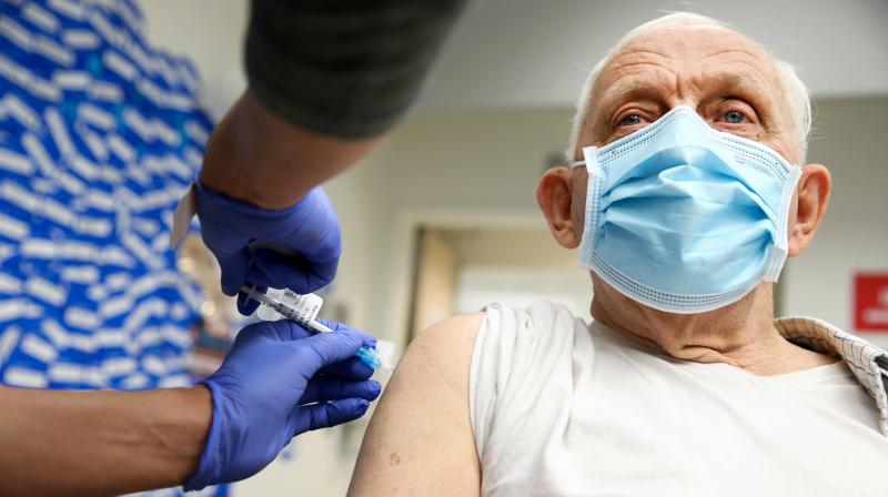 Anthony Banash receives a COVID-19 Pfizer vaccination at Harbor-UCLA Medical Center on January 21, 2021 in Torrance, California. Banash was the first patient to receive the vaccine at the hospital.  (Mario Tama/Getty Images/AFP)