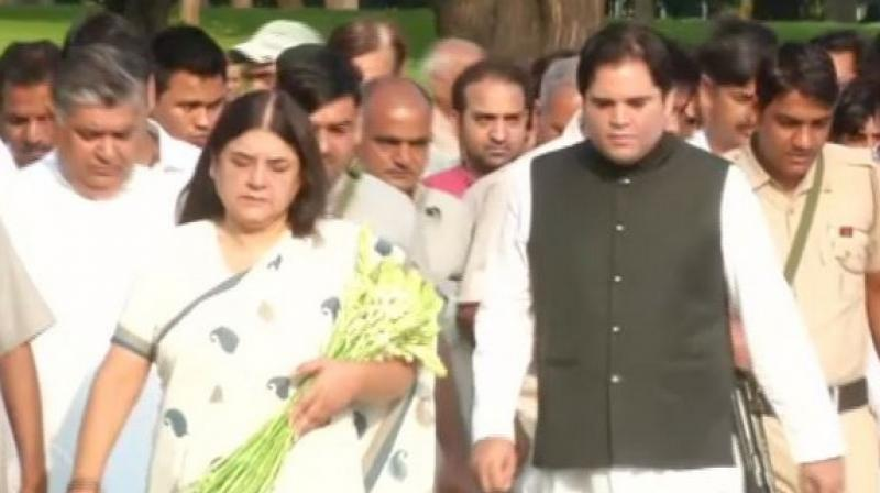 Both Maneka (wife of late Sanjay Gandhi) and Varun (son of late Sanjay Gandhi) paid floral tribute at the memorial, amid recital of hymns from the religious texts.  (Photo: ANI)