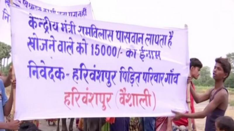 Villagers put up banners and pasted posters on their cattle on Saturday to convey their anguish against Paswan. (Photo: ANI)