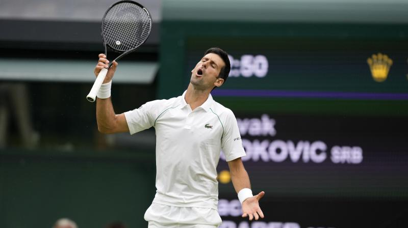 Serbia's Novak Djokovic reacts during his match against Britain's Jack Draper in the Wimbledon Tennis Championships in London on Monday. (Photo: AP)