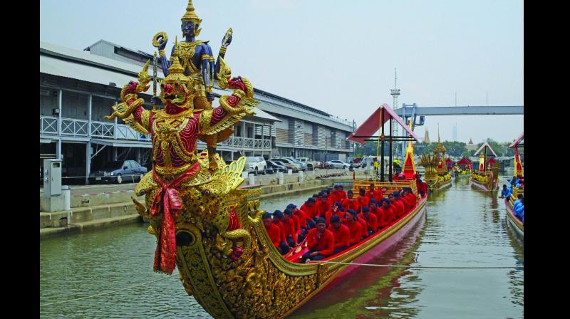 The royal barge procession sails down the Chaophaya. (Photo: Lekha Shankar)