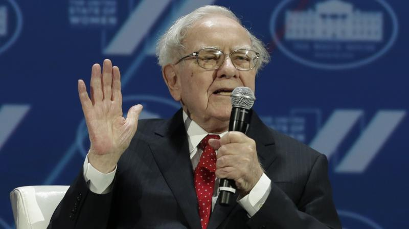 Warren Buffett, the chairman and chief executive of Berkshire Hathaway, also said Wednesday that he is halfway to reaching his goal of giving away the entirety of his shares in the conglomerate, and that he's making another USD 4.1 billion in donations. (AFP Photo)