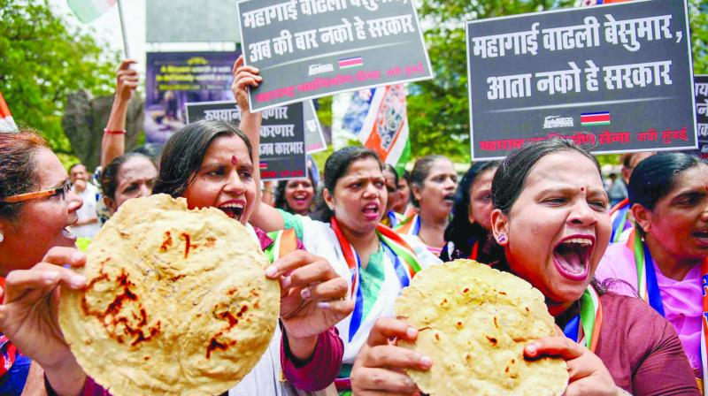 Members of MNS Women's Wing (left) stage a demonstration to protest against hike in fuel prices, in Navi Mumbai.