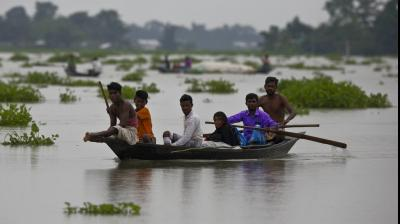 Indian flood affected villagers travel on boats in Burha Burhi village, east of Gauhati, Assam, India, Monday, July 15, 2019. (Photo: AP)