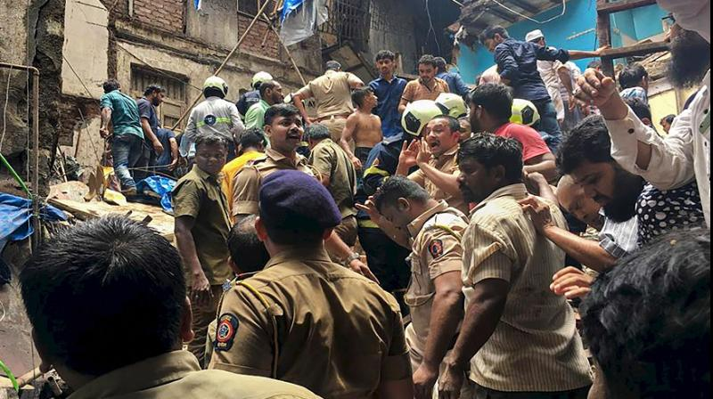 'This building must be 90-100 years old. I saw the bodies of some children. There were some seven-eight families in the building,' eyewitnesses said at the scene. (Photo: PTI)