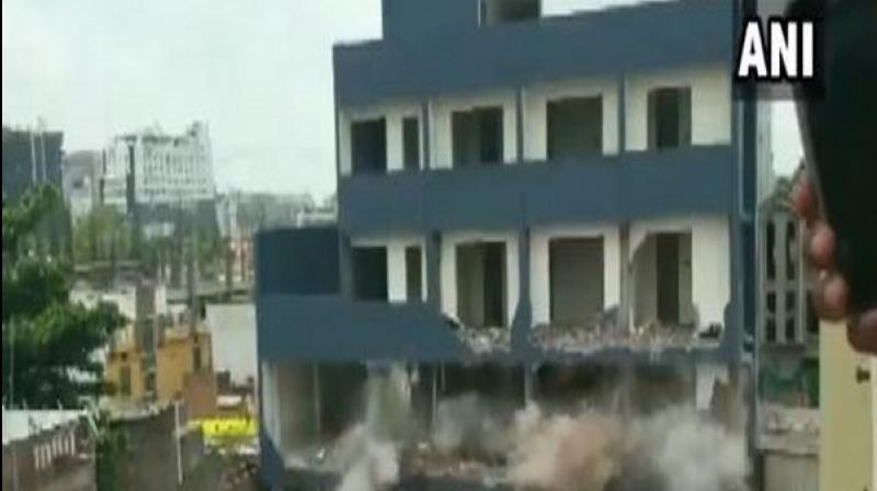 Dust rose up in the air as the structure came crashing down with a thud in the densely-populated area. (Photo: ANI)