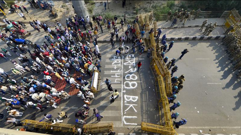 Bharatiya Kisan Union (BKU) members protest after police imposed section 144 at Ghazipur border, during their 'Delhi Chalo' march against the new farm laws, in New Delhi, Monday, Nov. 30, 2020. (PTI)