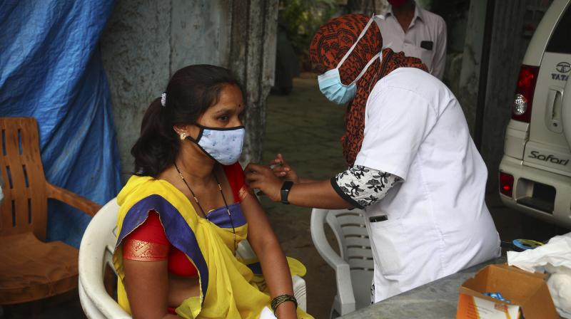 A health worker administers the Covishield vaccine during a special vaccination drive against COVID-19 in Hyderabad. (Photo: PTI)