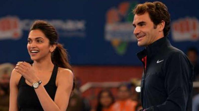 Deepika Padukone and Roger Federer at an event in New Delhi in 2014.