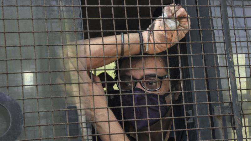 Indian television news anchor Arnab Goswami sits inside a police vehicle after he was produced in a court following his arrest in Mumbai, India, Wednesday, Nov. 4, 2020.(AP)
