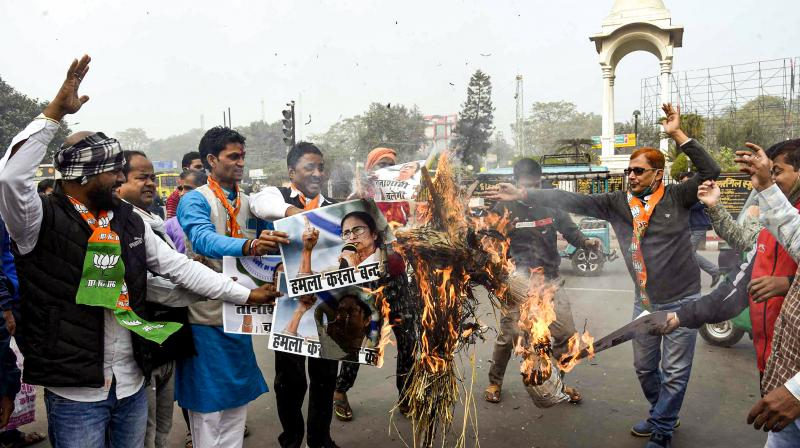 BJP workers burn an effigy of West Bengal Chief Minister Mamata Banerjee during a protest against the attack on party National President JP Nadda's convoy in West Bengal, in  Patna on Friday, December 11, 2020. (PTI)