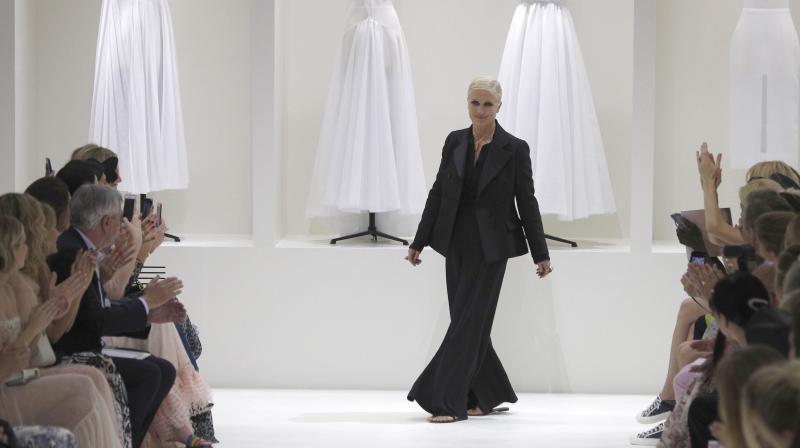 Designer Maria Grazia Chiuri accepts applause at the end of the Dior Haute  Couture Fall- de310f9359a6d