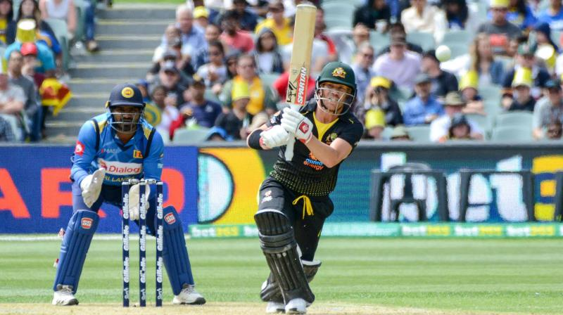 David Warner emphatically bounced back to form on his birthday, with a first-ever Twenty20 century as Australia crushed Sri Lanka by 134 runs in their opening match of the series in Adelaide on Sunday. (Photo:AFP)