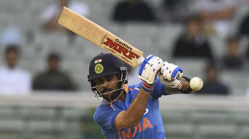 Kohli's 1,322 runs at an average of 55.08 with five centuries in 13 Tests and 1,202 runs at an astounding average of 133.55 with six hundreds in 14 ODIs saw him selected to both sides. (Photo: PTI)