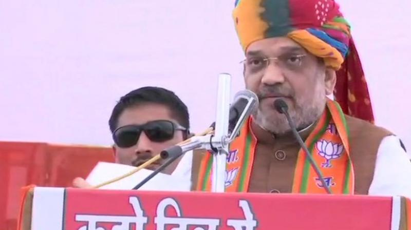 Addressing an election rally here, Shah said, 'I have been repeatedly asking Rahul Gandhi to name the leader of his party...But he doesn't say anything.' (Photo: ANI | Twitter)