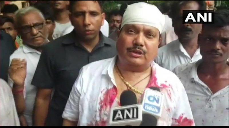 Singh said that he was going for a blood donation camp in the area when he saw a few TMC workers attempting to capture a local BJP office. (Photo: ANI)