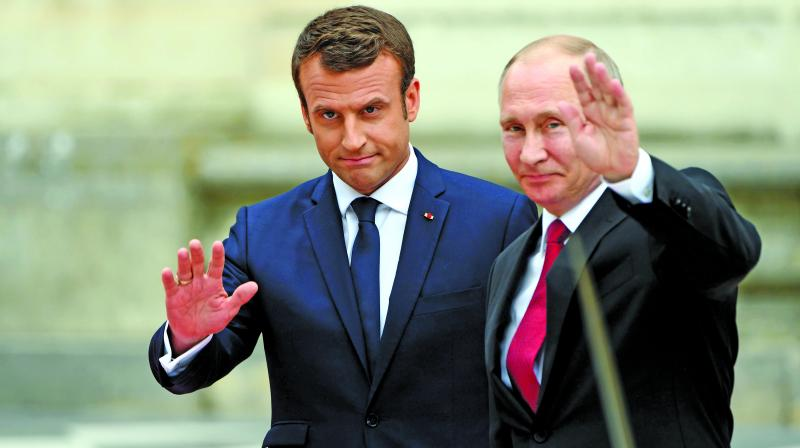 Russian President Vladimir Putin and his French  counterpart Emmanuel Macron arrive at the Versailles Palace, near Paris. (Photo: AFP)