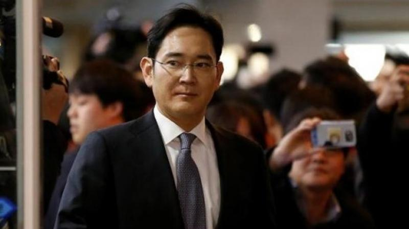 The vice-chairman of Samsung Electronics, 49, arrived at Seoul Central District Court on a justice ministry bus handcuffed (Photo: AP)