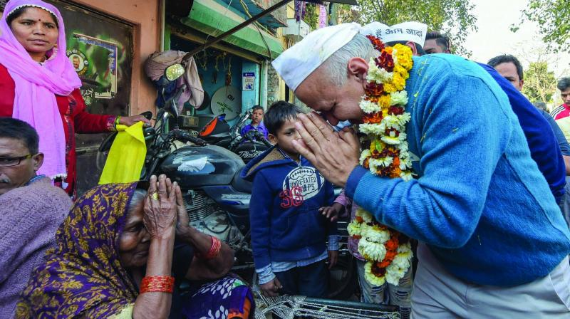 "AAP leader Manish Sisodia during the ""dhanywad yatra"" in Pataparganj in New Delhi on Wednesday after winning the Assembly elections. (Photo:  PTI)"