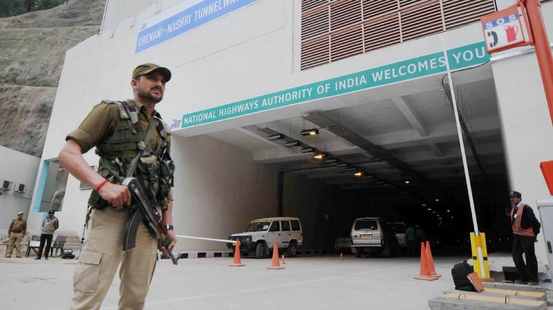 A security person stands guard outside Chenani-Nashri Tunnel on Jammu-Srinagar highway ahead of its inauguration, in Jammu. (Photo: PTI)