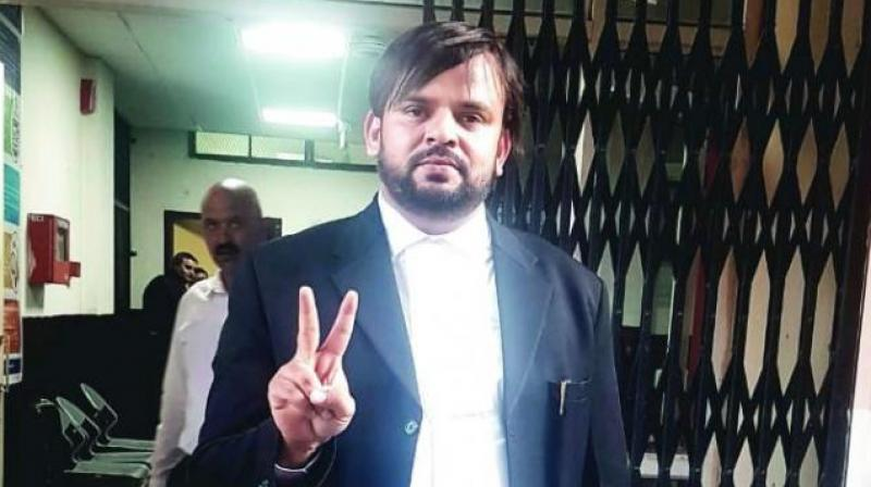 Mubeen Farooqi making a 'victory' sign outside the Court in Pathankot.
