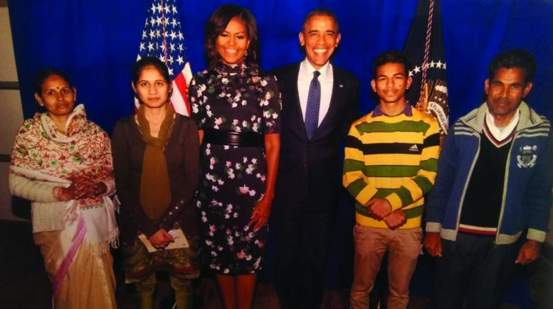 A file photo of Ramdas Ahirwar and his family with Barack Obama and wife Michelle. (Photo: Asian Age)