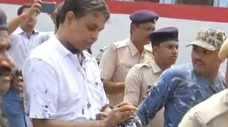A woman meanwhile threw ink at Thakur outside the court. (Photo: ANI | Twitter)