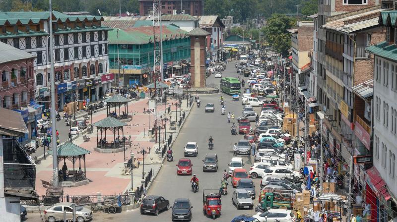 Vehicles ply on a street at Lal Chowk in Srinagar. PTI photo