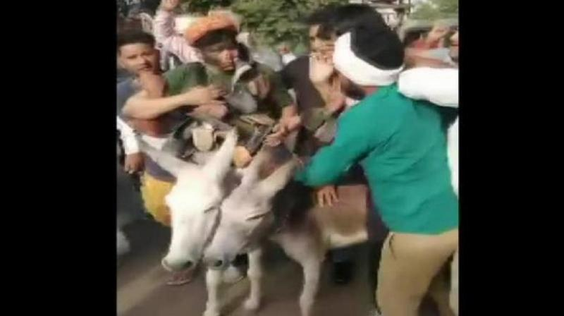 The accused had garlanded BSP national coordinator Ramji Gautam and former state president Sitaram with shoes, and blackened their faces on Tuesday. They also made Gautam sit on a donkey, and paraded him and Sitaram outside the party office at Bani Park. (Photo: ANI)