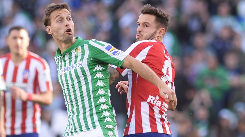 Atletico Madrid moved back into the top four in La Liga with a hard-fought 2-1 win at Real Betis on Sunday as they recorded back-to-back league victories for the first time since the beginning of September. (Photo:AFP)