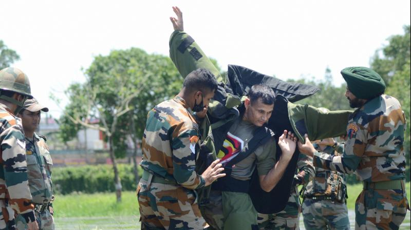A bomb disposal squad member of the Indian Army prepares to defuse two IEDs recovered from ULFA(I) cadres, at Polo Ground, near Paltan Bazar in Dibrugarh. PTI Photo