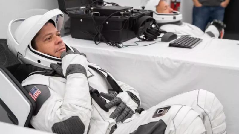 Astronauts Bob Behnken and Doug Hurley underwent 'suit-up procedures' at SpaceX headquarters in Hawthorne, California.