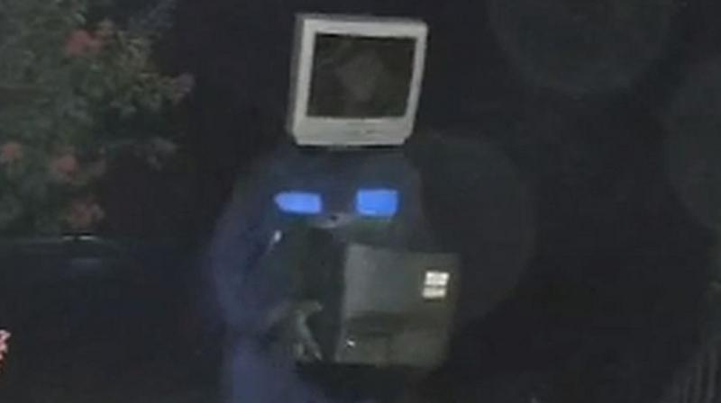 Doorbell surveillance cameras captured the man, wearing a TV set over his head, laying an older set down on someone's front porch and just walking off.