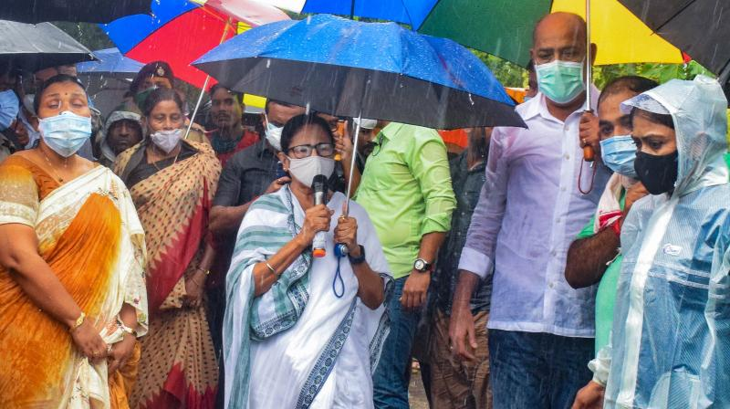 West Bengal Chief Minister Mamata Banerjee addresses during visiting flood-affected Amta area in Howrah district, Wednesday, Aug. 4, 2021. (PTI Photo)